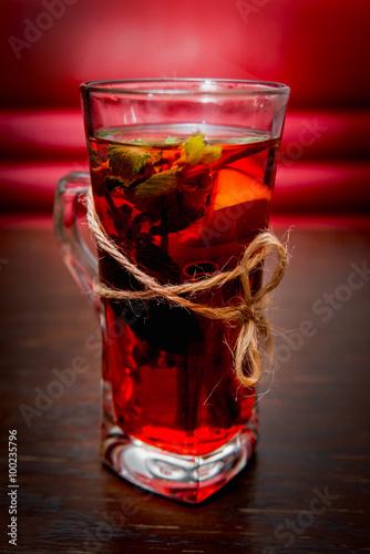 Fotografie, Obraz  Hot herbal tea in a glass