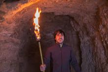 Adventurous Torch Inside Cave