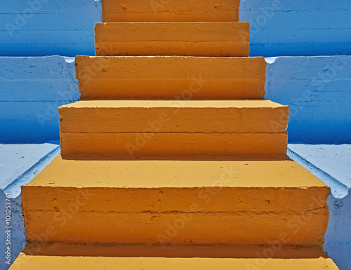 Photo Stands Stairs vibrant orange stair and blue background