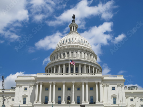 Fotografia, Obraz  The US Capitol Building in Washington, DC with blue, cloudy sky background