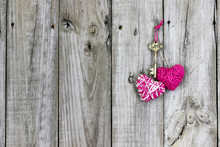 Key And Hearts Hanging On Rust...