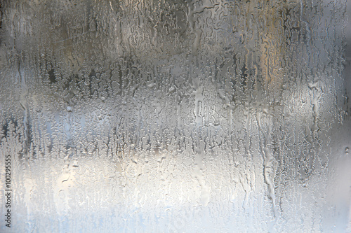Fotografija Frozen drops on frosted glass. Winter textured background.