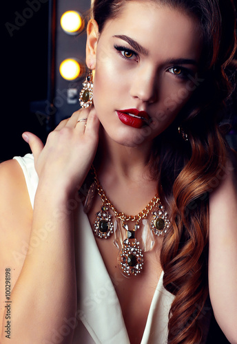 b6c6197ce5c gorgeous woman with long dark curly hair wears elegant dress and luxurious  necklace
