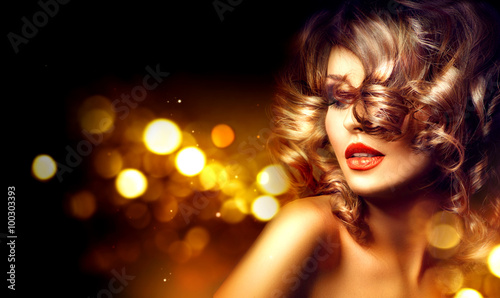 Fotografie, Obraz  Beauty woman with beautiful makeup and curly hairstyle over holiday dark backgro
