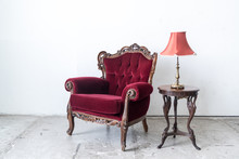 Vintage Sofa And Lamp On White Wall.