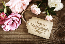 Valentines Message With Pink Roses On Wooden Table