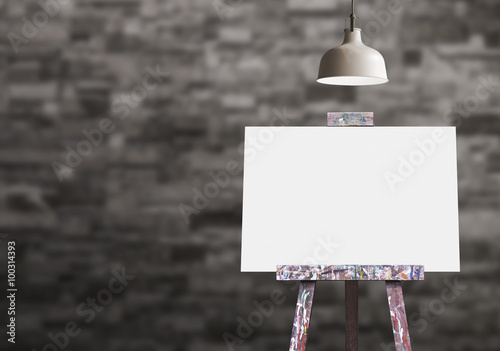 Photo  Wooden easel with blank painting canvas in the room