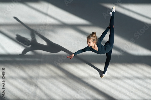 little girl doing balance on rhythmic gymnastics