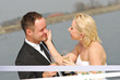 Attractive wedding couple bride and groom posing with lake landscape