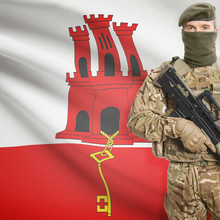 Soldier With Machine Gun And Flag On Background - Gibraltar