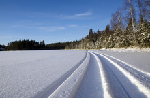 Snowmobile Trail On A Lake With A Blue Sky In Background, Picture From The North Of Sweden.