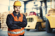 Worker in front of forklift