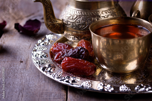 Fotografie, Obraz  Traditional arabic tea set and dried dates.