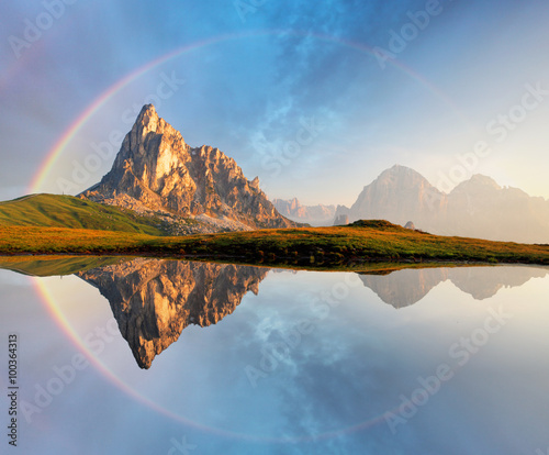 Deurstickers Bergen Rainbow over Mountain lake reflection, Dolomites, Passo Giau