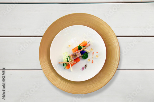 Fotografie, Obraz  Colorful dish on a white table