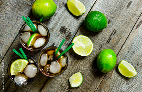 Fresh cocktail with lime and mint on wooden table. Canvas Print