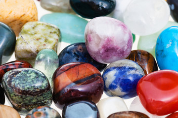 handful of various gem stones close up