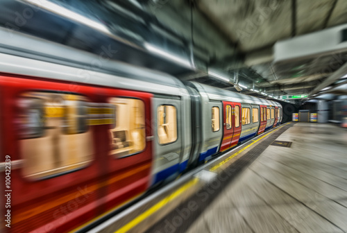 Fotografering Fast moving subway train in London underground station
