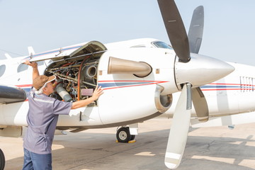 Aircraft engineer with  check several before flight