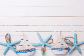 NaklejkaBorder from decorative sailing boats and marine items on wooden