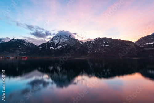 Deurstickers Reflectie Mountains Alps. Mountain landscape at night. Sky is colored by the setting sun is reflected in the surface of the water.