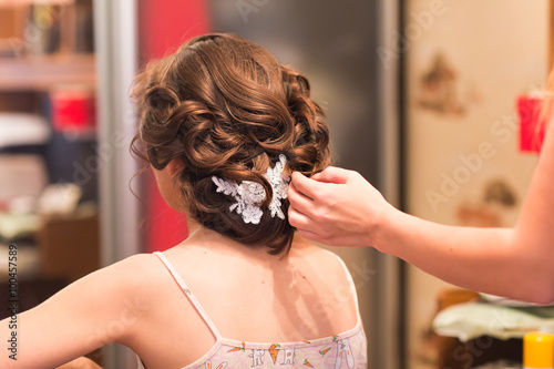 Hair stylist makes the bride before a wedding. Poster