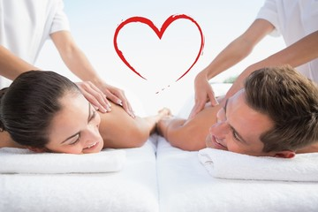 Peaceful couple enjoying couples massage