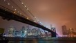 Time lapse of the Brooklyn Bridge overlooking the East River to Manhattan at night.