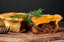 Piece Of Australian Meat Pie With Rosemary