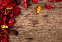 Red Potpourri Flower Petals On Wooden Background