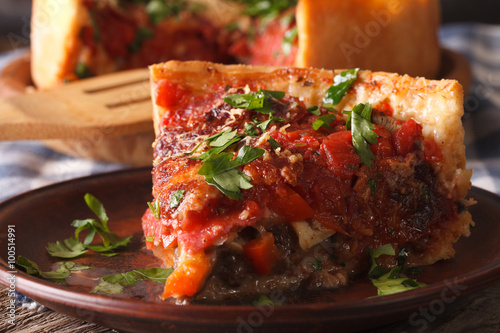 Poster Plat cuisine Slice of Chicago deep dish pizza on a plate macro. Horizontal