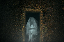 Frightening Ghost In A Catacomb Full Of Bones
