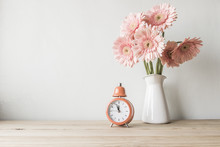 Flowers And  Alarm Clock On A ...