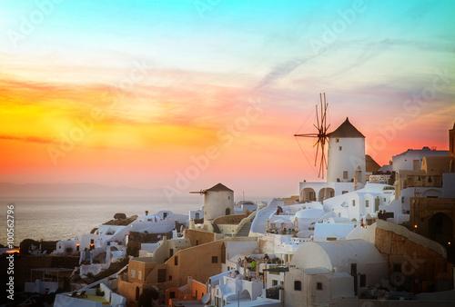 Poster Light pink windmill of Oia at sunset, Santorini