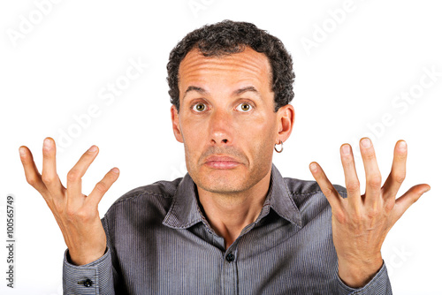 Valokuva  Portrait of confused man giving I don't know gesture on white background