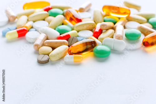Fotografie, Obraz  Vitamins, omega 3, cod-liver oil, dietary supplement and tablets an embankment o