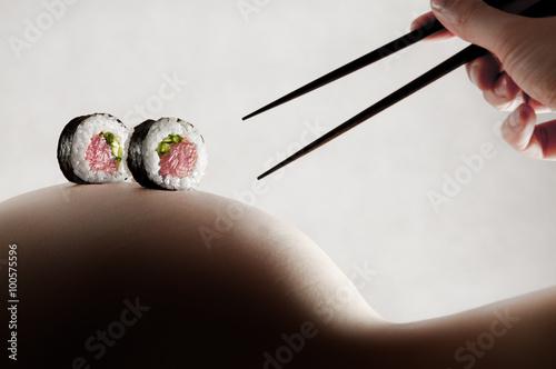 Foto op Aluminium Sushi bar Body sushi - rolls on a naked woman