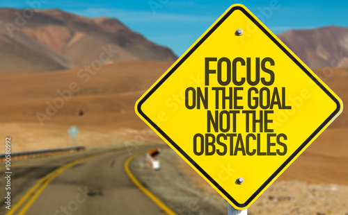 Focus On The Goal Not The Obstacles sign on desert road Canvas Print