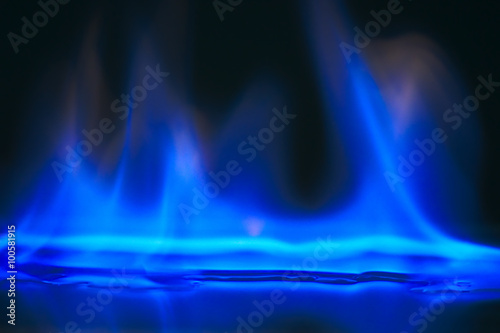 Fotobehang Vuur Alcohol burning blue flame.