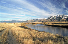 Gallatin River And Mountains In Montana, US.
