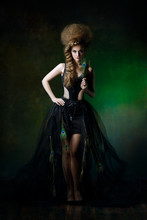 Sexy Woman In A Dress With Peacock Feathers And Creative Hairstyle