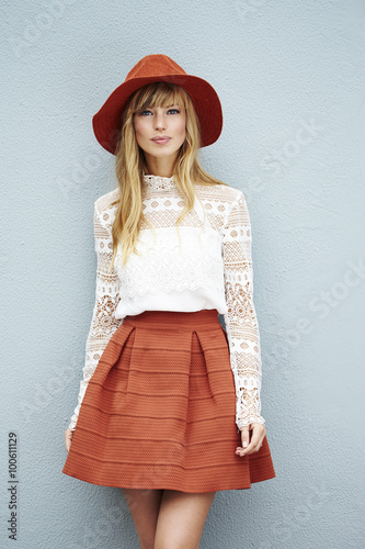 Gorgeous young blond fashion model in hat, portrait Wall mural
