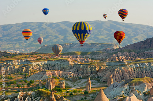 Ingelijste posters Ballon Colorful hot air balloons flying over the valley at Cappadocia