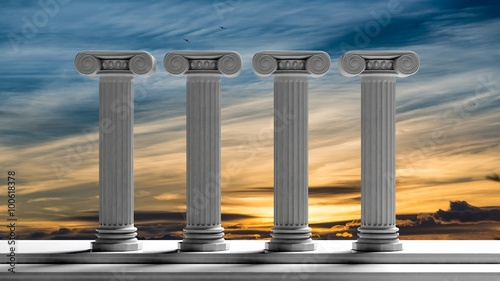 Fotografía Four ancient pillars with sunset sky background.