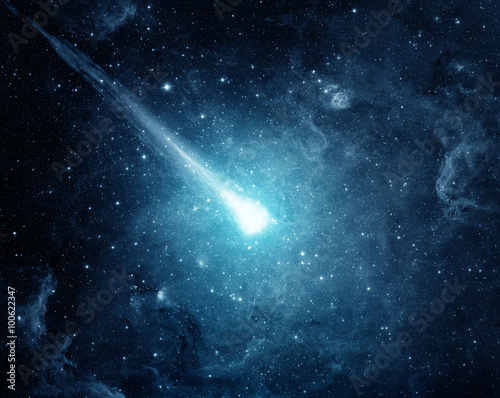 Comet in the starry sky. Elements of this image furnished by NASA.