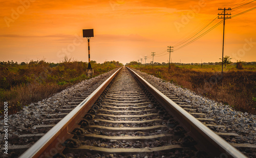 Poster Voies ferrées Railway Track in a Rural Scene at Sunrise Time.
