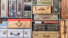 Pile Of Colorful Vintage Suitcases.