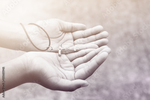 Slika na platnu Hand with a rosary against gray background, religious concept
