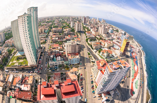 In de dag Havana Bird eye aerial view of Havana city capital of Cuba in latina america - Detail of skyscrapers in modern downtown business district - Skyline with fisheye lens distortion and warm saturated color tones