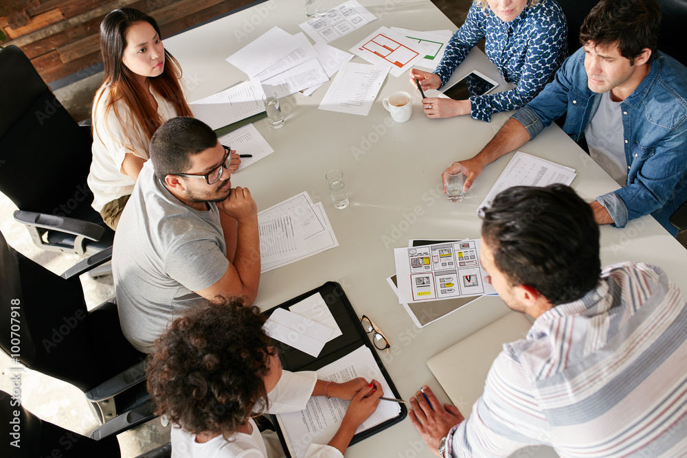 Fototapety, obrazy: Team of creative professionals meeting in conference room